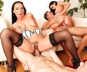 Salacious hotties have an interracial groupsex encircling well-hung guys