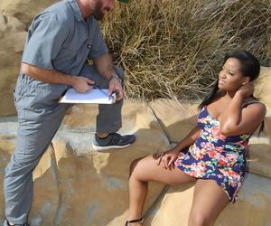 Horny black chick Monique Symone seduces the courier in a short dress