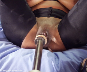 Bog boobed female Africa pleasures themselves with a sexual relations machine above her bed