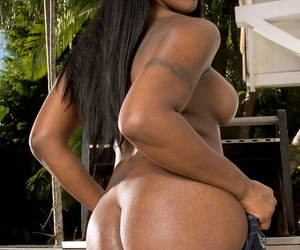 Hot black chick Barbie Banx flaunts her big booty as she gets naked on deck