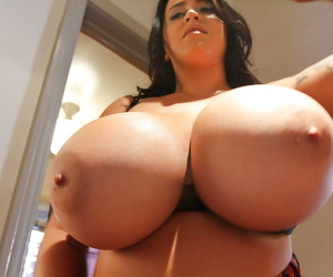 European pornstar Leanne Crow flaunting massive juggs in granny boots