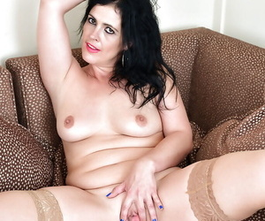 Aged Euro lady Montse Swinger delving fingers into snatch wearing tan nylons