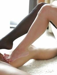 Euro pornstar Anita Bellini taking cumshot on barefeet after giving handjob