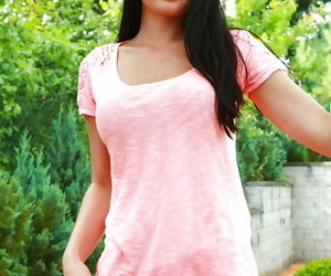 Brunette Euro babe Lucy Li releasing large teen breasts outdoors
