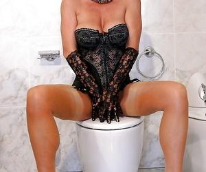 Aged blonde nylon model Amazing Astrid posing in lingerie on toilet