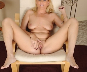 Blonde spoil with beamy knockers smiling and undressing will not hear of beautiful body