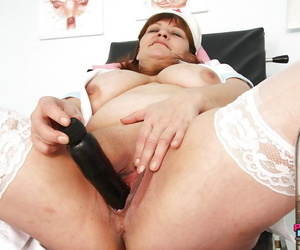 Filthy mature plumper in nurse uniform toying her shaved gloryhole