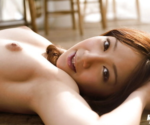 Busty asian babe Ryo Akanishi taking off her lingerie top