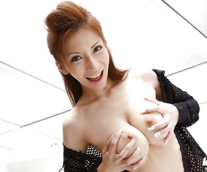 Seductive asian babe on high heels uncovering her amazing big tits