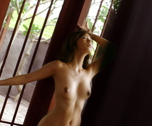 Pretty asian babe with sexy ass stripping off even her panties