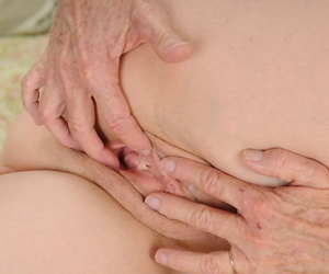 Aged woman Annabelle Brady removes her panties to finger her beaver