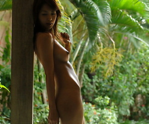 Alluring asian babe with tiny tits stripping off her bikini
