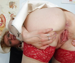 Saucy mature care in glasses showcasing their way boobs increased by soaking wet cunt