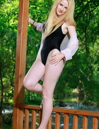 Swimsuit clad European Fay Love strips outdoors to show hairy pussy