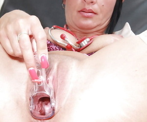 Sassy mature nurse stuffing her twat with gyno tools in close up