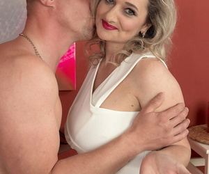 Horny old mature Amelie Azzure treats her boy toy to a blowjob and titjob
