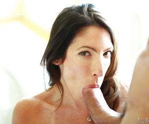Cumshot scene with a brunette mature Dava Foxx doing blowjob
