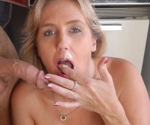 Mature blonde plumper Wanda tit smothering man in kitchen before oral sex