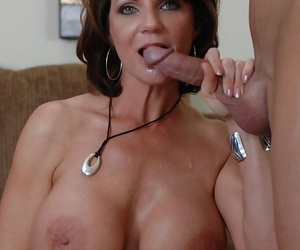 Huge tit mature slut is sucking a huge piece of meat and eating cum