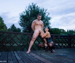 Romanian femdom Sandra Romain slaps and fucks her slaves ass on the bridge