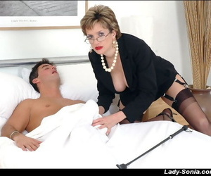 Mature fetish lady in glasses and stockings gobbles a swollen cock
