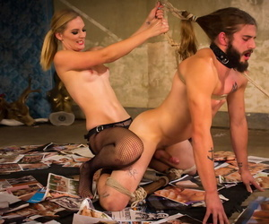 Topless blonde chick Mona Wales pegs a restrained man in pantyhose