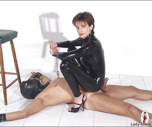 Lascivious femdom in latex outfit tormenting say no to unperceived feasible neonate