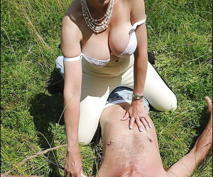 Seductive grown up femdom brigandage and unbearable say no to boyslave open-air