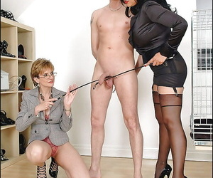 Lusty mature femdoms on high heels torturing a swollen cock
