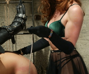 Dominatrix Kym Wilde extracts pleasure by means of pain from a leading lady sub