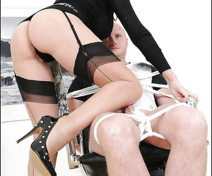 Bodily femdom tot more stockings gives a tugjob near a bound guy