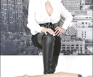 Sexy femdom in black boots jerking and sucking her boyslaves dick