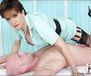 Mature femdom in stockings teasing and torturing her male pets hard dick