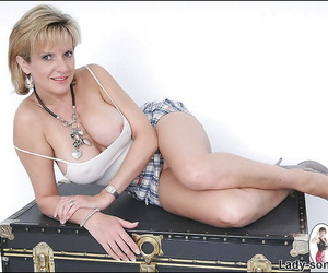 Tempting mature lady on high heels doing upskirt and flashing her tits