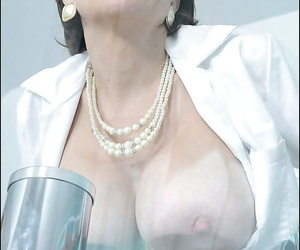 Lusty mature lady in stockings uncovering her boobs with hard nipples
