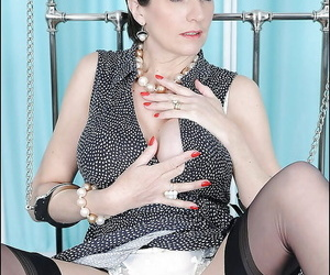 Fully clothed mature fetish lady posing chained and flashing her panties