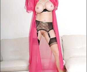 Curvy matured charm lassie posing in XXX unmentionables and sheer one\'s glad rags b put on a costume