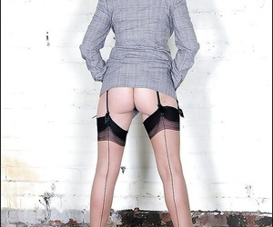 Mature fetish lady in formal suit reveals her tits and lifts up her skirt