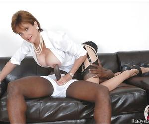 Salacious mature shrew in nylon stockings jerking off a swollen black cock