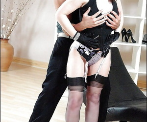 Mature fetish lady in stockings gives some oral pleasure to a studly lad