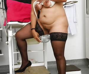 Dumpy Indian woman Alice buccaneering apropos to stockings concerning gyno office