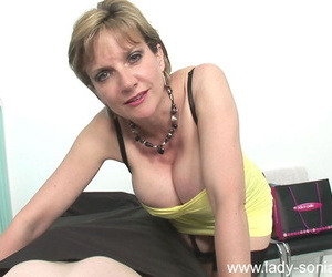 Lustful mature lady toying her cunt and blowing a rigid dick