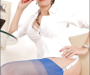 Bottomless mature lady in glasses teasing her slit through her panties
