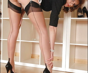 Hot mature babe in glasses teasing her pussy under her panties