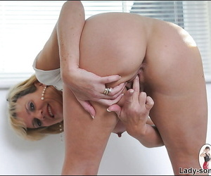 Big busted mature lassie lowering her tights and fingering her cunt