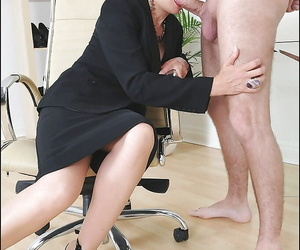 Mature fetish daughter in formal suit gives a sloppy blowjob