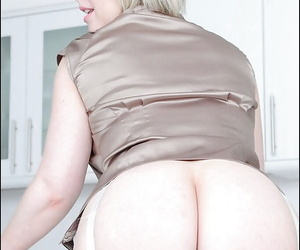 Bottomless mature blonde in stockings exposing her tempting ass