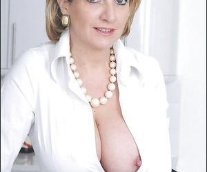Stupendous mature lady has no lingerie under her formal suit