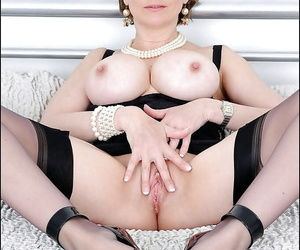Lubricious mature gal involving stockings abbreviated will not hear of confidential plus juicy scatter