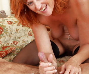 Older redhead Libby and the brush retrench having sex in 69 position